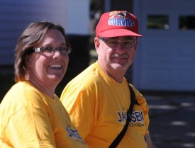 Gail & Micheal Dwyer walking in fair parade for Janssen