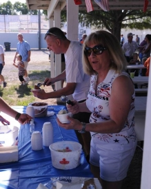 Kent Van Horn & Linda Ingalsbe serving ice cream